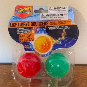 Light wave Bouncers light-up skim balls on water